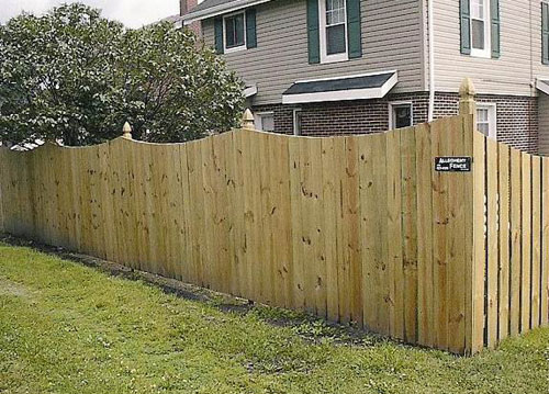 scallped wood fence solid