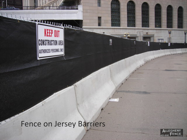 Fence on Jersey Barriers